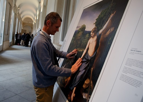 MADRID, SPAIN - FEBRUARY 10: A blind person feels with his hands a copy of 'Don't touch me' (Noli me tangere) of Antonio da Correggio at The Prado Museum on February 10, 2015 in Madrid, Spain. 'Hoy toca el Prado' (Touch The Prado) allows blind or vision-impaired visitors to explore with their hands the copies of six masterworks. The copies were created using a technique called 'Didu' which provides texture and volume to the paintings. (Photo by Pablo Blazquez Dominguez/Getty Images)